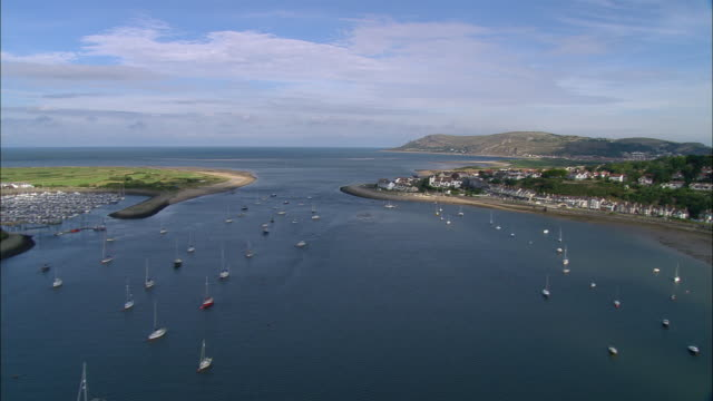 aerial, yachts sailing in harbor, conwy, wales - sailing boat stock videos & royalty-free footage