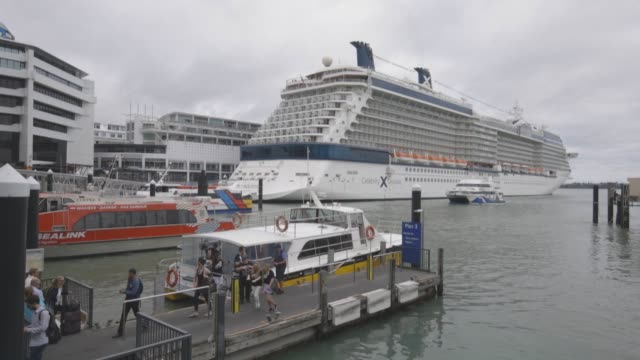 Yachts sit moored at a marina as the Sky Tower center and other buildings stand in the distance in Auckland New Zealand on Friday Dec 9 A Celebrity...