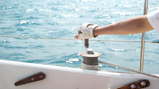 yachtsman sails controls - mast sailing stock videos & royalty-free footage