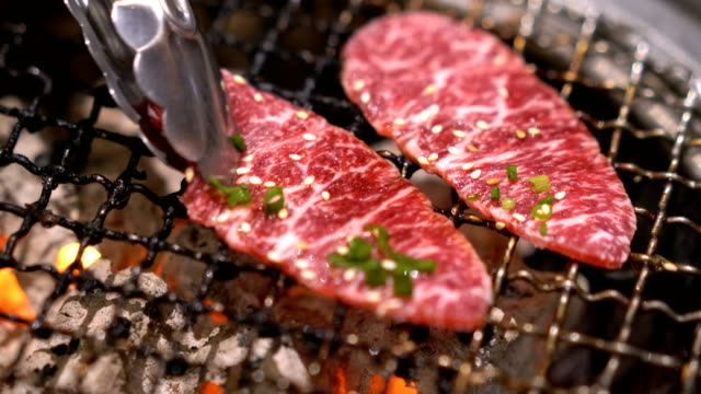 yakiniku,  beef grilling on fire japanese styles. - roast dinner stock videos & royalty-free footage