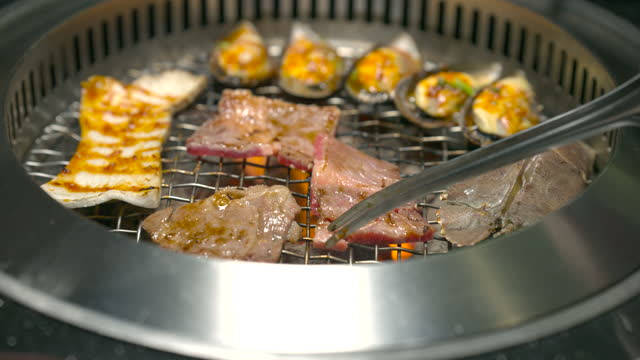 yakiniku-style grilled japanese style fresh premium beef is delicious. - japanese food stock videos & royalty-free footage