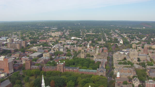 WS AERIAL POV Yale University campus with Harkness Tower, tree area in background / New Haven, Connecticut, United States