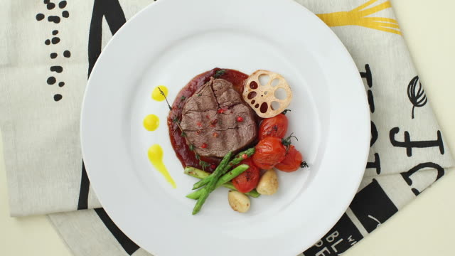 cu ha yammy steak placed on table / seoul, south korea - plate stock videos & royalty-free footage