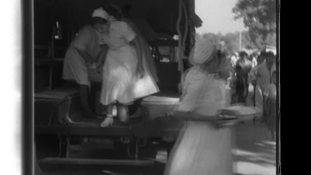 Yangon residents deal with the aftermath of Allied bombings Burmese nurses and medical units treat the wounded Commander Shojiro Iida presents the...