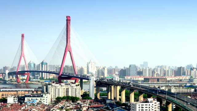 yangpu bridge elevated traffic from day to night - motorway stock videos & royalty-free footage