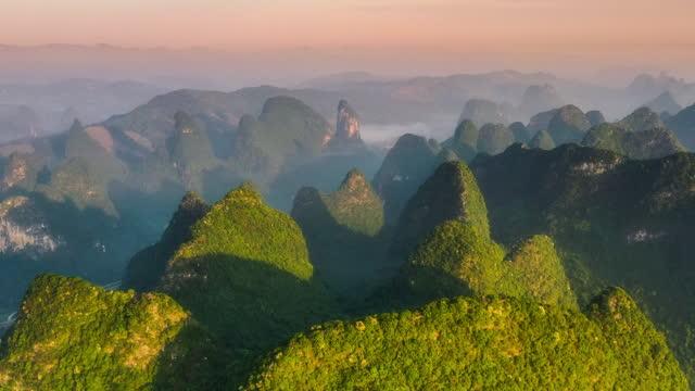 yangshuo karst peak forest in the twilight - mountain ridge stock videos & royalty-free footage