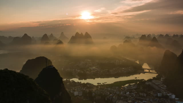 yangshuo timelapse at sunrise - guilin stock videos & royalty-free footage