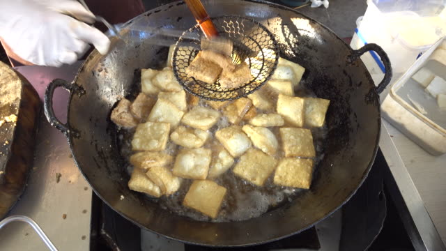 traditional deepfried relish tofu different from other places in china yangzhou deepfried tofu is not famous for the stinky smell but the crisp and... - chinese food stock videos & royalty-free footage