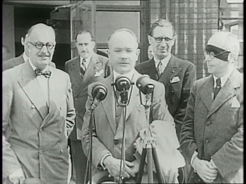 yankee clipper lands in new york city harbor / new vichy france ambassador gaston henryhaye disembarks the plane and shakes hands with a man waves... - botschafter stock-videos und b-roll-filmmaterial