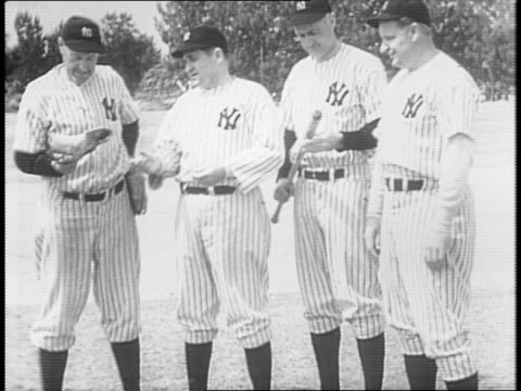 stockvideo's en b-roll-footage met yankee players with manager joe mccarthy on field / joe dimaggio packs bag at home with wife, bids family members goodbye / yankee players run onto... - atlete
