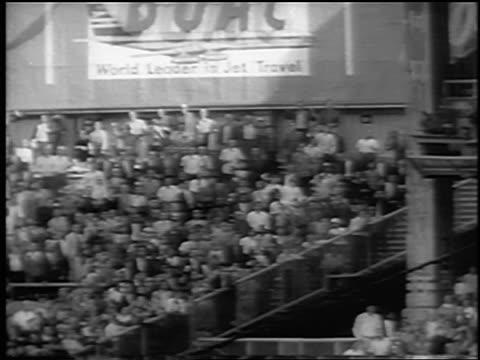 vídeos y material grabado en eventos de stock de yankee roger maris hitting home run to break babe ruth's single season record / newsreel - uniforme de béisbol