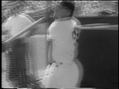 vídeos de stock, filmes e b-roll de yankee roger maris swinging + hitting ball in spring training / newsreel - liga esportiva