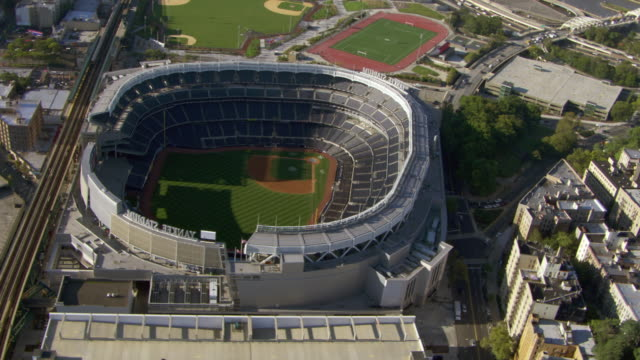 Yankee Stadium encloses a baseball field in New York City.