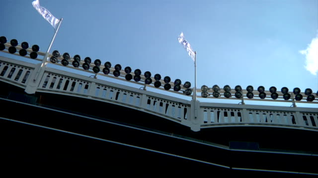 Yankee Stadium frieze roof w/ flags ballpark lights clear blue sky BG NYC NY Yankees Bronx Bombers MLB baseball