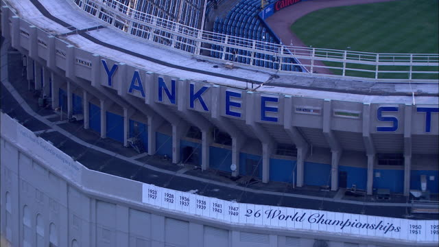 AROUND 'Yankee Stadium' sign FLYING to reveal empty stadium seats field New York Yankees Bronx Bombers Major League Baseball MLB