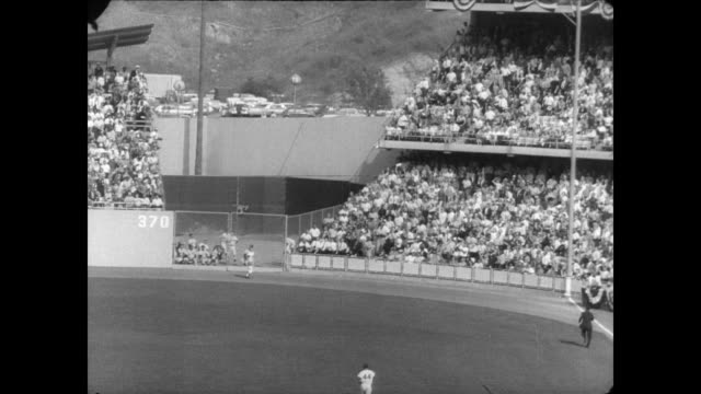 NY Yankees at Dodgers Stadium for third game of World Series / packed stadium watches the game / specific players mentioned are Jim Bouton Don...