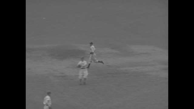 yankees' frank crossetti at bat in polo grounds, he hits ball, is thrown out at first / yankees' george selkirk hits home run, rounds bases and... - nfc east stock videos & royalty-free footage