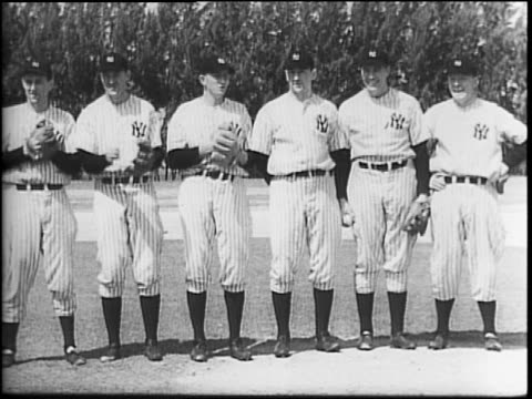 yankees in st petersburg florida for training camp / players in uniform lined up with partners doing exercises and stretches / montage of practice /... - spring training stock videos & royalty-free footage