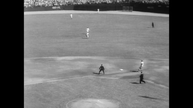NY Yankees meet LA Dodgers at Yankee Stadium / press operate camera as game begins / Sandy Koufax pitches / well dressed crowd in sunshine cheer and...