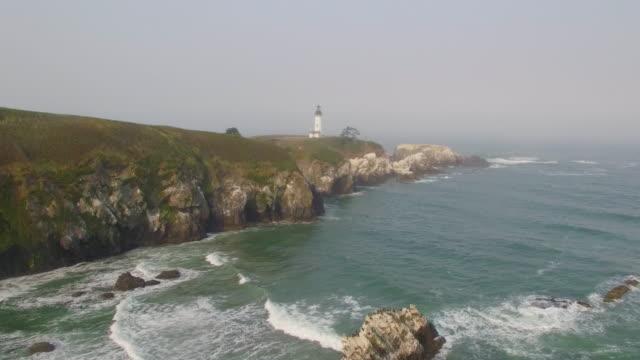 yaquina head lighthouse oregon coast - newport oregon stock videos & royalty-free footage