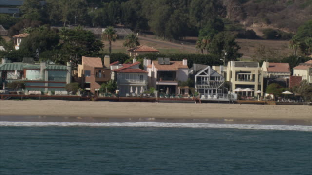 aerial yards of beach houses fronting pacific coast / malibu, california, united states - malibu beach stock videos & royalty-free footage