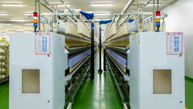 yarn spinning machine - textile industry stock videos & royalty-free footage