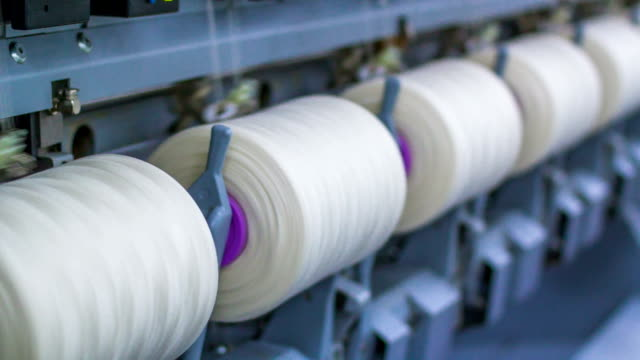 yarn spools on spinning machine in a factory - cotton stock videos & royalty-free footage