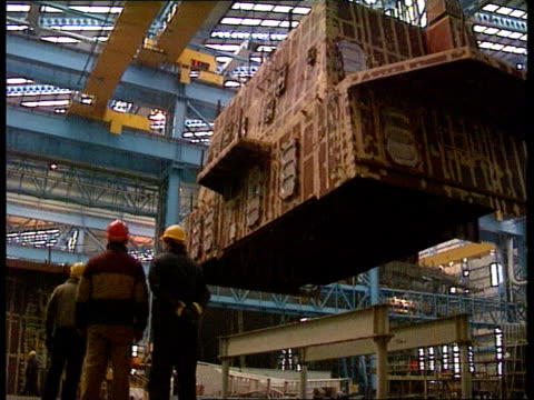 glasgow gv yarrow shipbuilders with ship in dock zoom in lalms shipyard workers next container lowered on crane cms shipyard worker wearing hard hat... - yard measurement stock videos and b-roll footage