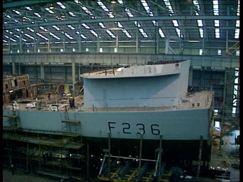 Yarrow shipyard new contract CF TAPE NO LONGER AVAILABLE SCOTLAND Glasgow MS Shipyard workers welding bow section of Type 23 Frigate under...