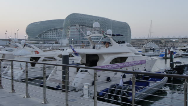 Yas Viceroy Hotel and Yas Marina at dusk, Yas Island, Abu Dhabi, Middle East, Asia