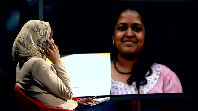 yashika bageerathi deported to mauritius despite last minute court appeal general view reporter in studio talking to yashika bageerathi on phone... - deported stock videos & royalty-free footage