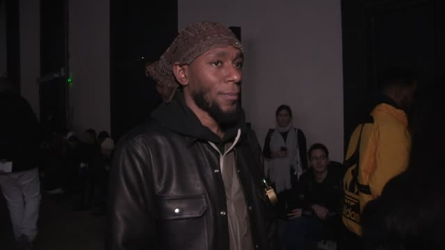 yasiin bey aka mos def, takashi murakami, casey spooner and more front row for the rick owens menswear fall winter 2019 fashion show in paris. - mos def stock videos & royalty-free footage