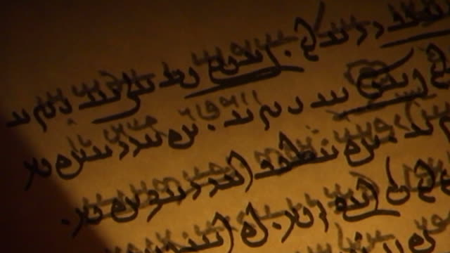 yasna scriptures. tilt-down of a page of the yasna or primary liturgical collection of avesta texts which are recited during the zoroastrian yasna... - yazd province stock videos & royalty-free footage