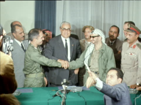 yasser arafat shaking hands with king hussein of jordan after signing peace treaty at tunisian embassy; oct 70 - palestine liberation organisation stock videos & royalty-free footage