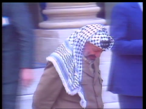 Yasser Arafat visit FRANCE Paris Elysee Palace Arafat leaving building accompanied by French officials