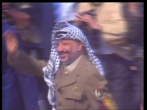 Yasser Arafat visit FRANCE Paris Orly Airport SEQ Yasser Arafat off Iraqi Airways plane greeted by various third world diplomats along Elysee Palace...