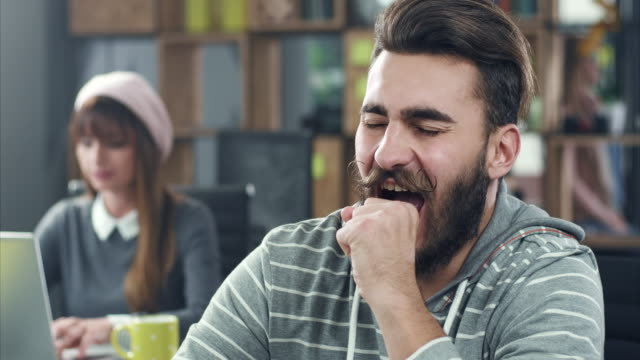 yawning at workplace - yawning stock videos & royalty-free footage