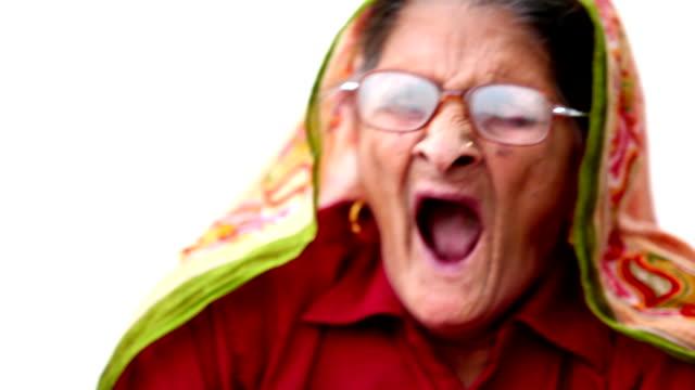Yawning old woman