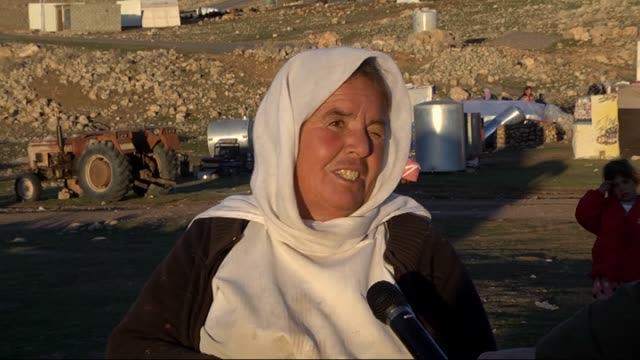 yazidis flee from daesh threat suffer from cold weather conditions on the mountains of sinjar town in mosul iraq on 8 december 2015 - sinjar stock videos & royalty-free footage
