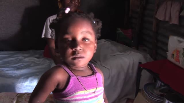 year after the earthquake, haitians are still clustered by the thousands in makeshift camps intended to offer only temporary shelter after their own... - temporary stock videos & royalty-free footage