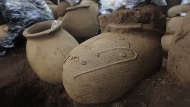 a 1200 year old archaeological site with human bones and ceramic urns has been discovered to the east of the capital of nicaragua whilst builders... - decorative urn stock videos and b-roll footage