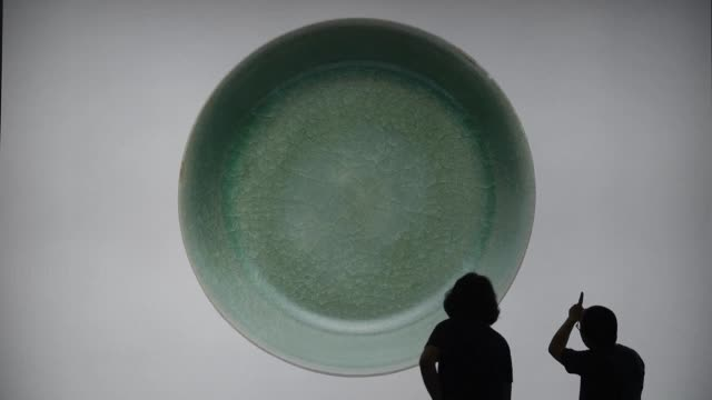 a 1000 year old bowl from china's song dynasty sold for us$377 million in hong kong breaking the record for chinese ceramics auction house sotheby's... - sotheby's stock videos and b-roll footage