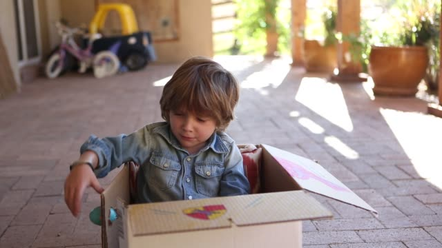 4 year old boy and cardboard box - front porch stock videos and b-roll footage