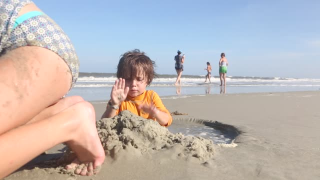 3 year old boy at the beach