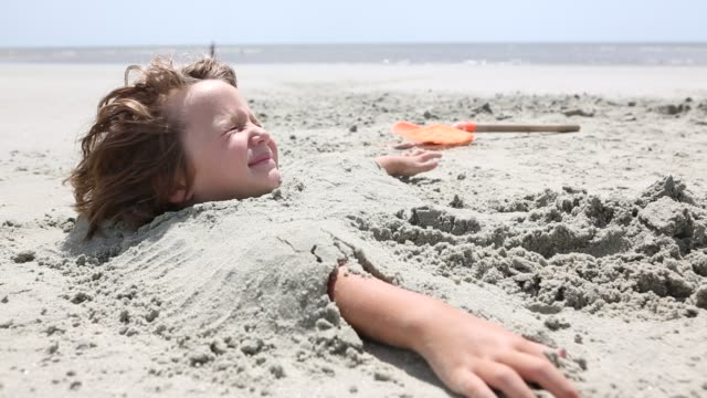 4 year old boy buried in sand - buried stock videos & royalty-free footage