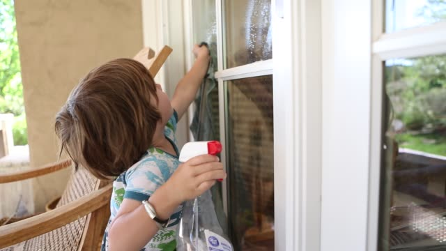 3 year old boy cleaning windows - housework stock videos and b-roll footage
