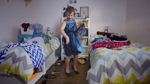 8 year old boy dances in his shiny blue dress and high heels - camera moves in and out