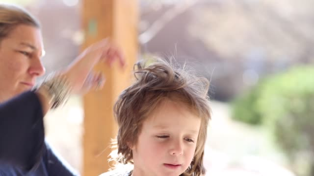 4 year old boy getting his hair cut