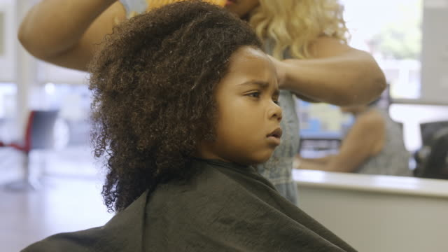 4 year old boy getting his very first haircut. - afro hairstyle stock videos & royalty-free footage