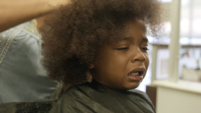 4 year old boy getting his very first haircut. - long hair stock videos & royalty-free footage